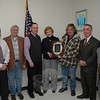 Two former longtime members of the Police Commission were honored this week by the current membership of the agency, which oversees town police activities and local traffic control. Carol Mattegat and Robert Connor, who recently left the agency, were honored for their more than 20 years of membership. Pictured at a January 5 Police Commission session are the five current commission members and the two honorees. From left is James Viadero, Bruce Walczak, Brian Budd, Ms Mattegat, Mr Connor, Duane Giannini, and Keith Jacobs.  (Gorosko photo)