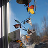 A delicate butterfly wind chime twirls in the window at Life's A Peach.  (Crevier photo)