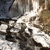 The Pootatuck River in Sandy Hook serves as a spectacular outdoor thermometer for those who live, work, or travel along its serpentine path shadowing Glen Road. This week, the river reported subfreezing temperatures with its encroaching epaulettes of ice and snow and cascading frozen seeps from the rock outcrops and ledges along its banks.  (Bobowick photo)'
