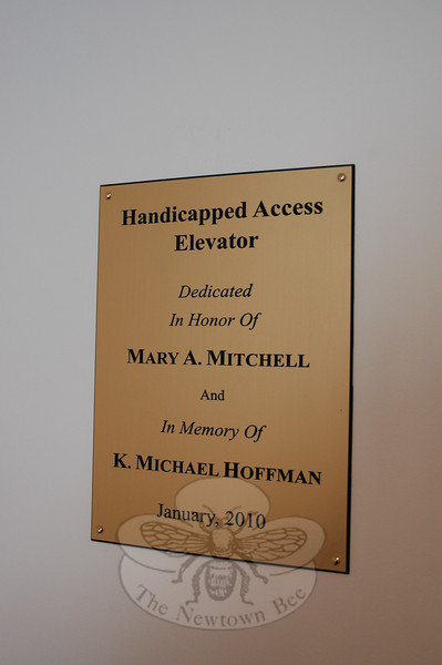 A new plaque at Newtown Meeting House denotes work done by Mary Mitchell and Pamela Hoffman, who donated seed money to fund the installation of the elevator and organized several musical fundraisers, respectively, for a recently-installed elevator in the historic building.  (Crevier photo)