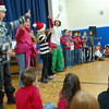 Middle Gate students, sang, played music and shared holiday riddles during their school's annual schoolwide holiday sing-along.  (Hallabeck photo)