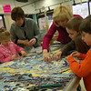 "Superintendent of Schools Janet Robinson, middle right, helped Head O' Meadow first grade students place ceramic tile pieces on what will be an art installation at Head O' Meadow. The finished project will be a four panel re-creation of Van Gogh's ""Starry Night."" (Hallabeck photo)"