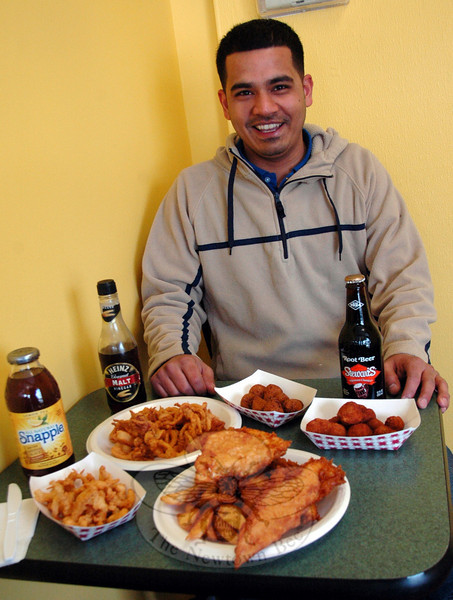 This table full of crispy and authentic treats — breaded mushrooms, hush puppies, haddock, cod, chicken, chips, calamari, and clam strips — represents just a sample of the available fare at Royal Fish & Chips in Stony Hill. Owner Saquib Zafar can prepare a single item made to order, or feed a whole gang with his family meal specials.  (Voket photo)