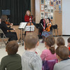 Members of New Haven Symphony Orchestra visited Sandy Hook Elementary School on Tuesday, December 22, for a PTA-sponsored cultural arts schoolwide assembly. Violinist Joanna Becker, left, violinist David Southorn, back left, cellist Laura Usiskin, standing, and violist Janice LaMarre shared information about the music they were performing and its composers with the gathered students.  (Hallabeck photo)
