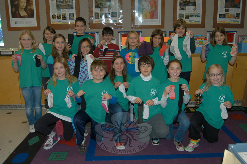 Members of Middle Gate's RRD Club, also called The Green Team, stand with socks and mittens collected for its Sock & Mitten Drive, which will finish up by the end of January, collecting for Bridgeport and Danbury shelters.  (Hallabeck photo)