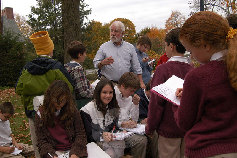 Newtown's Town Historian Dan Cruson, center, led St Rose School students on a walking history tour of Main Street on October 21.  (Hallabeck photo)