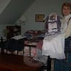 Marjorie Czarsty displays a special occasion skirt and hand bag that she made from strips of her late husband's dress shirts, while wearing a three-tiered skirt created from his flannel shirts. Over her shoulder is a wool bag made from one of Mr Czarsty's sweaters. Wearing the recycled clothing keeps her close to her late husband, she says.  (Crevier photo)