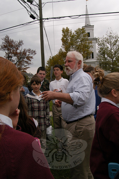 Newtown's Town Historian Dan Cruson led St Rose School students on a walking history tour of Main Street on October 21.  (Hallabeck photo)