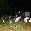 Charlie and Patricia Muehlfeld went all out with their decorations this year, erecting more than 36 homemade headstones, ghosts, and motion-sensitive lights in their front yard.  (Hicks photo)  ** See the Halloween 2009 Gallery for more photos of Halloween in Newtown. **
