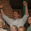 Arms raised in victory, John Kortze cheered for his Republican party members and for his own reelection to the Board of Finance.  (Bobowick photo)