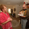 Louise Butler was eager to welcome Mason Rich Goessinger into her apartment Saturday to receive free pastries and coffee that he and other Masons delivered as part of their Senior Appreciation Day outreach effort.  (Bobowick photo)