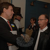 Many of the candidates for this season's municipal elections attended a pre-debate meet and greet Monday night at Edmond Town Hall including Democratic First Selectman candidate Gary Fetzer, left, speaking with resident and former Director of Finance Ben Spragg.  (Bobowick photo)