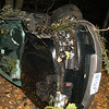 A 16-year-old boy was driving a 2005 Saturn Vue westward on Alberts Hill Road about 2 am on October 17, when the vehicle went off the road's right shoulder entered a wooded area, struck a tree, and then overturned. All four teenage occupants were able to exit the vehicle, police said. The driver received chest and neck injuries from the vehicle's seatbelt. A 15-year-old male rear-seat passenger received facial, head, and shoulder injuries said. Newtown ambulance volunteers transported both the driver and that passenger to Danbury Hospital for treatment of injuries. The two other passengers, who are a 14-year-old boy and a 14-year-old girl, left the accident scene before emergency personnel arrived, police said. Both passengers were later located and had received minor injuries in the crash, police said. Sandy Hook firefighters responded to the accident. The driver was driving the vehicle with a learner's permit and without the required supervision of a licensed driver, police said. Police withheld the identity of the driver because he is under age 18. The accident is under investigation and en-forcement is pending.  (Hicks photo)