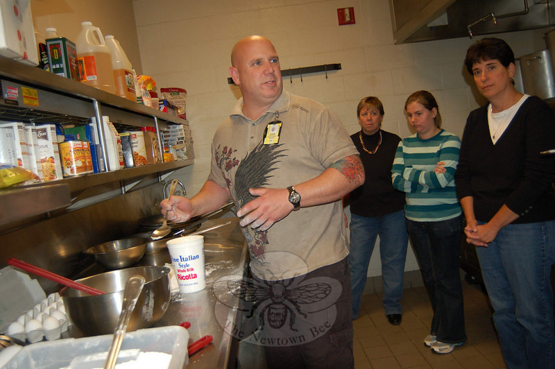 """Newtown High School culinary teacher Stephen OShana demonstrated how to make gnocchi to his Newtown Con-tinuing Education course, """"Cooking — Italian, Latin and Asian Style.""""  (Hallabeck photo)"""