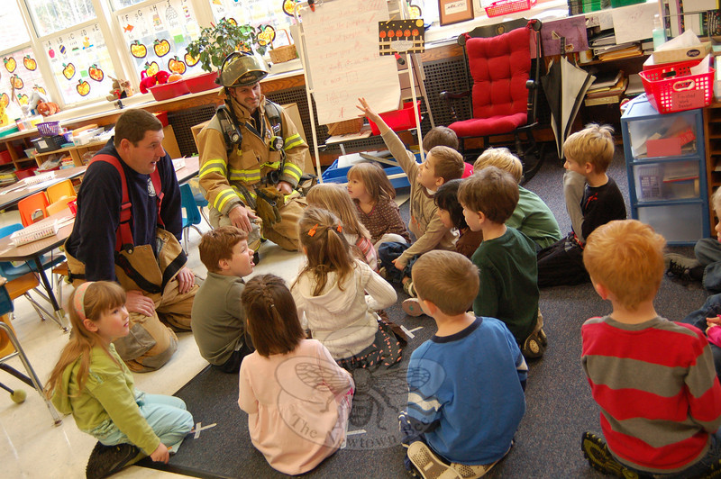 Hook & Ladder Company members Chris Ward, left, and Luke Duval spoke to kindergarten students in Marilyn Aylward's class at Hawley School on Friday, October 16, to teach the students about fire prevention.  (Hallabeck photo)