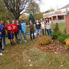 "Members of Newtown Middle School Student Council stayed after school on Tuesday, October 20, to help in the yearly ""Fall Beautification"" effort. Student Council advisors Linda Dale Mulholland, Nadia Papalia and Rose Ann Beck oversaw the effort, which planted mums near the sign now reminding students and residents that the Cookie Dough Sale is still underway until October 30.  (Hallabeck photo)"