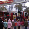 Hook & Ladder Company member Ray Corbo stood outside Hawley School on Friday, October 16, with other members of the company, to share information about fire prevention with the students.  (Hallabeck photo)