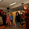 Booth Library's Mask & Wig Players, the library's young adult theater group, performed Freaky Phil's Costume Shop on October 18. Martha Bishop, the group's teacher (at right), introduced the play. (Bobowick photo)