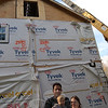 Doug and Roxann Monaghan, and Connor, stand in front of the modular home erected Thursday, October 22, at their Still Hill Road address. The Monaghans elected to replace a small, 100-year-old structure with a four-section Colonial modular unit, finding it a more affordable way to build in this economy. Work crews placed the sections in just under ten hours and will be finished building it out in just five to six weeks.  (Crevier photo)