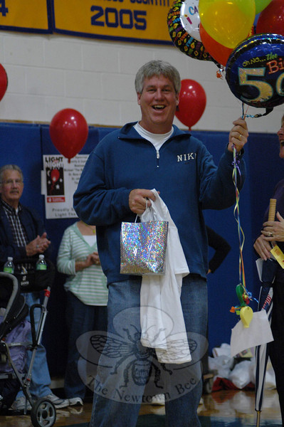 Newtown High School Athletic Director Gregg Simon was surprised during the Mini Light the Night event at NHS on October 24 with an acknowledgement of a milestone birthday.  (Gorosko photo)