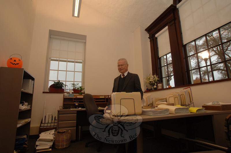 First Selectman Joe Borst stands in the chaotic jumble of unpacked paperwork and materials waiting to be reorganized in the new first selectman's suite of rooms at Newtown Municipal Center.  (Bobowick photo)