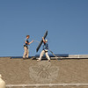 Greg and Craig Teschendorf installed 30 solar panels on the roof at Reed Intermediate school on October 22.  (Bobowick photo)