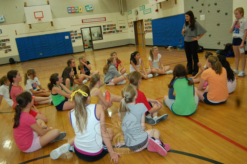 Tryouts for the Newtown Middle School Cheerleaders began Monday, October 26. NMS teacher Brooke Unger, above, oversaw the event, with help from captains Ryanne Duffy and Carly Sullivan and head cheerleaders Sami Chanko and Samantha Luzietti.  (Hallabeck photo)
