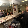 Dean Dottie Mangone points to a room designed to practice hair styling and cutting techniques before working with clients. In the mirror is the group from Ability Beyond Disabil-ity who recently visited the Main Street South academy.  (Bobowick photo)