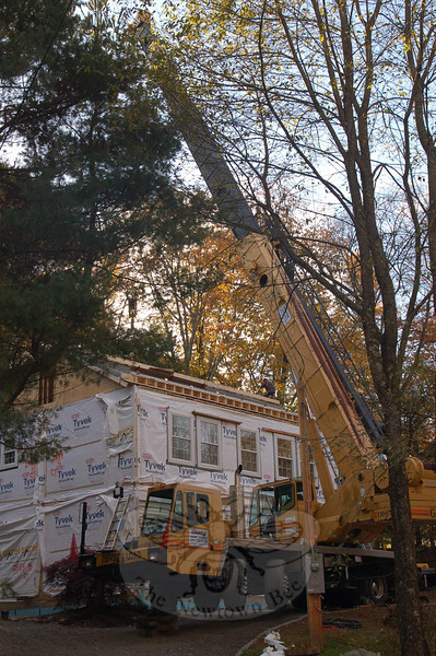 Doug and Roxann Monaghan elected to replace a small, 100-year-old structure on Still Hill Road with a four-section Colonial modular unit, finding it a more affordable way to build in this economy. Work crews will be finished building the new home in just five to six weeks.  (Crevier photo)