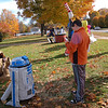 Newtown Middle School Photography Club members, overseen by NMS art teacher Arlene Spoonfeather, snapped photos on October 26 of this year's entries for the Scarecrow Sculpture Contest set up on the school's front lawn. The scarecrows and miscellaneous sculptures were scheduled to remain at the middle school until October 30.  (Hallabeck photo)