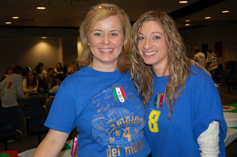 Newtown High School Italian teachers Laura Battisti, left, and Diana Pistritto waited in the school's Lecture Hall on Friday, October 16, to welcome their Italian language students to the yearly event celebrating Italian Heritage.  (Hallabeck photo)