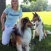 Susan Hurtuk, owner of Pawtown Dog Walking & Pet Sitting Service, poses with Gryphon and Seelie during a recent outing to Fairfield Hills.  (Voket photo)