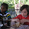 Fresh Air guest Davonte, left, eats lunch with Quinn Fitzgerald at the Villa during his visit this summer.