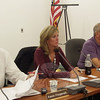 Kathryn Fetchick, center, takes her seat September 16 on the Legislative Council between Kevin Fitzgerald, left, and Robert Merola. Ms Fetchick, who had resigned her seat as vice chair of the school board one day earlier, was unanimously endorsed to fill a Republican council vacancy, and was subsequently seated as chair of the council's Education Committee.  (Voket photo)