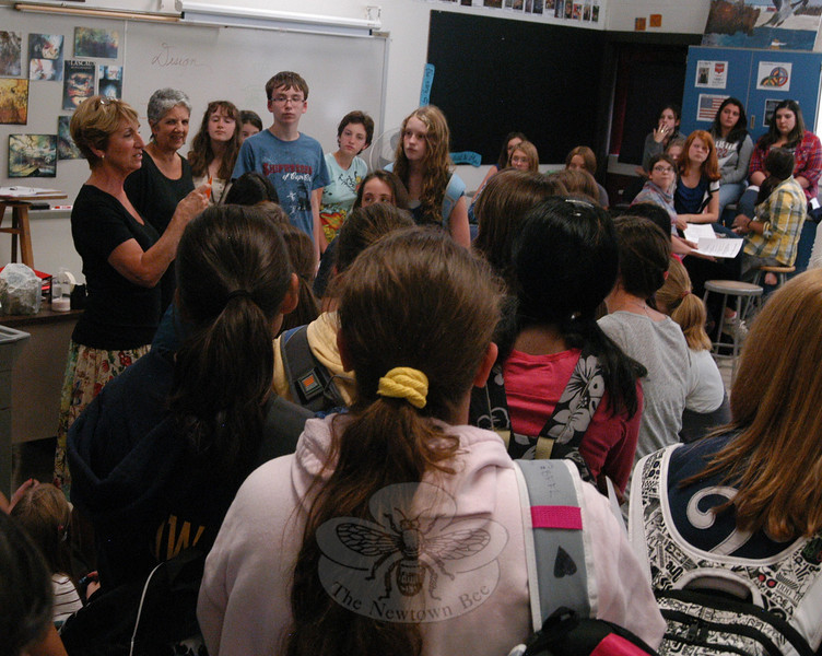 Newtown Middle School art teachers Claudia Mitchell, left, and Arlene Spoonfeather speak to a room of interested Scarecrow Sculpture Contest entrants on Tuesday, September 14.  (Hallabeck photo)