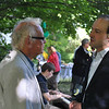 "Dr Z. Michael Tahweh, right, director of Kevin's Community Center (KCC) in Newtown, a clinic providing free medical care to the uninsured and underinsured in town, greets Midhat Serbagi at the Saturday, September 11 ""Mozart, Merlot, and Mums"" fundraiser/silent auction for the health care clinic. Mr Serbagi, the brother of KCC supporter, musician, and conductor, the late Richard Serbagi, provided viola music for the afternoon dedicated to the memory of his brother.  (Crevier photo)"