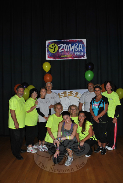 American Society For Scleroderma Research (ASFSR) foundation board members gather before the Master Zumba Class fundraiser, Friday evening, September 10, at Reed Intermediate School. From left, standing, are Bob Cesare, vice president ASFSR, Gina Swanson, Joy Loschiavo, Joe Loschiavo, president ASFSR, Lou Turiano, secretary ASFSR, Linda Turiano, treasurer ASFSR, and Lisa Spiegel; kneeling are Linda Loschiavo, Zumba instructor Jordana Bross Bell, and Lisa Tilson. The Loschiavo family founded AFSFR when Joy was diagnosed with scleroderma, an autoimmune disease that attacks collagen production and that presently has no cure. Amy Turiano, daughter of Lou and Linda Turiano, is also fighting scleroderma, as is board member Lisa Spiegel.  (Crevier photo)