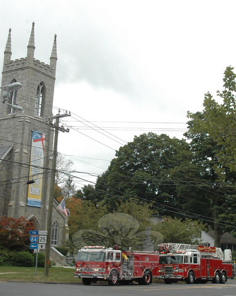 Volunteers from Newtown Hook & Ladder were surprise guests at Trinity Episcopal Church around 9:30 last Sunday morning after responding to a call about an odor of gas in the area. Volunteers remained on the scene for some time, and a technician eventually responded from the gas utility, but there was no reported outcome regarding a source.  (Voket photo)