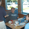 Connecticut State Senator Republican Sam Caligiuri, contending for the fifth US Congressional District, visited the Blue Colony Diner to mingle with residents and shake hands on September 4. Mr Caligiuri came across many travelers from other states and visitors from area towns, but also found Newtown's Dale Walter, who was enjoying breakfast with his daughter Grace, 11, and friend Emily Booth, 10.  (Hutchison photo)