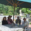Carol Garbarino, treasurer of the Newtown Scholarship Association (NSA), left, and Debby Osborne, NSA board member, right, join owners Annie Stiefel and Tim Currier of Sticks and Stones Farm in inviting the public to support the Newtown Scholarship Association at a Harvest Wine Tasting, Saturday, September 25, at Sticks and Stones Farm, 201 Huntingtown Road, from 4:30 to 7:30 pm. Sandy Hook Wine & Liquor will provide more than 50 wines from around the world for tasting. Hors d'oeuvres will be served, and there will be a silent and a live auction. Tickets can be purchased for $35 at Sandy Hook Wine & Liquor on Church Hill Road in Sandy Hook Center, or by calling Carol Garbarino at 203-426-7713.  (Crevier photo)