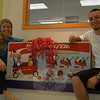 The Learning Experience (TLE), a child development center on South Main Street, owner and operator Danielle Van Riper, left, presented a deluxe family wagon to Lee Swanson on Thursday, August 26. Mr Swanson was entered to win the raffle after attending TLE's grand opening ceremony earlier in the summer. While visiting his daughter, Kaelyn, at TLE on Thursday, Mr Swanson promised her a ride in the wagon when she got home from her day at TLE.  (Hallabeck photo)