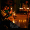 Justin Bogdanoff was the picture of concentration on December 7, when he was lighting his family's Hanukiah during a community event at Congregation Adath Israel. The synagogue hosted a Community Candle Lighting & Potluck Dinner, which included the candle lighting, singing, dinner and a performance bythe recenrty formed Adath Israel Choir.  (Hicks photo)