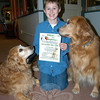 """Hawley Elementary School fourth grade student Bobby Elston is collecting donations for his """"Presents For Puppies"""" community service project through Saturday, December 12, to help support the Newtown Dog Pound.  (Hallabeck photo)"""