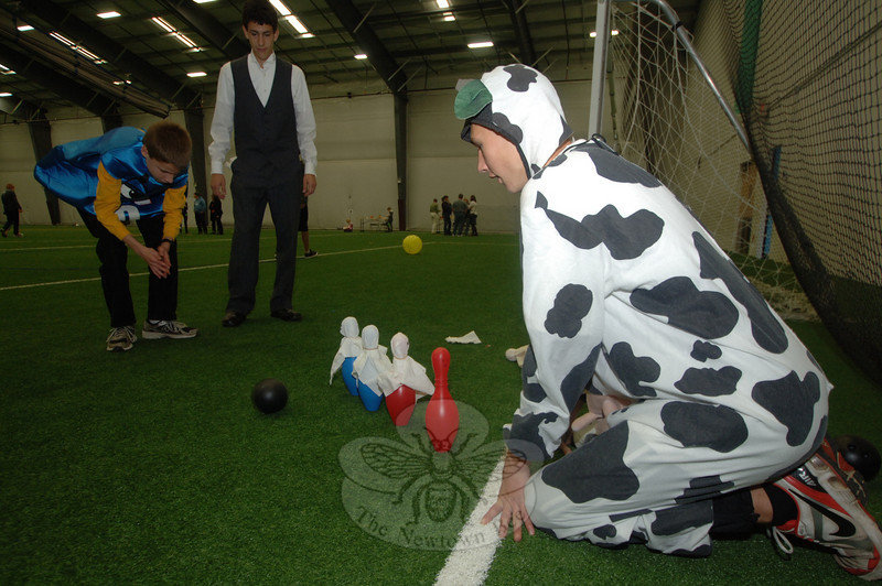 The first activity sponsored by Families United in Newtown (FUN) took place on Halloween at Newtown Youth Academy. FUN enlisted almost two dozen Newtown High School students, who supervised 15 children for about an hour while their parents enjoyed a catered lunch and socializing. Honors Society student Greg Campbell helped Kevin to bowl as another honors student, Travis LeBlanc (dressed as a dairy cow), lined up the pins.  (Bobowick photo)