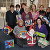 "As in years past, Coldwell Banker, 45 South Main Street, once more began collecting Toys For Tots right after Thanksgiving, and as of this week, had filled two conference rooms more than once with toy donations. The toys are collected regularly by a representative of the US Marine Corps for distribution to needy children around the state. ""We are still collecting toys through this Saturday, December 18,"" said realtor Kathy Quinn, who organized this year's Coldwell Banker effort, adding that the company also assisted the recent Newtown police toy drive. Pictured with just a few of the many toys donated are Coldwell Banker staff members, kneeling on left, Joan Salbu, and kneeling on right, Dolores Sullivan. Standing from left are Andree Gabathuler, Doreen Kostecki, Karen Alpi, Kim Mraz, Diane Tyrrell, Kathy Quinn, and Kathy Suhoza.  (Crevier photo)"