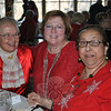 Marilyn Morrisey, Terry Pellicci, and Rosina Garcia celebrated the holiday season and their friendship before the luncheon began.  (Crevier photo)