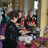 Hungry diners lined up at the roast beef carving station during the Newtown Senior Center Holiday Luncheon at the Waterview. Party guests also had a choice of grilled swordfish, and chicken piccata to accompany roasted potatoes, buttered vegetables, and caramelized onion-topped bread.  (Crevier photo)