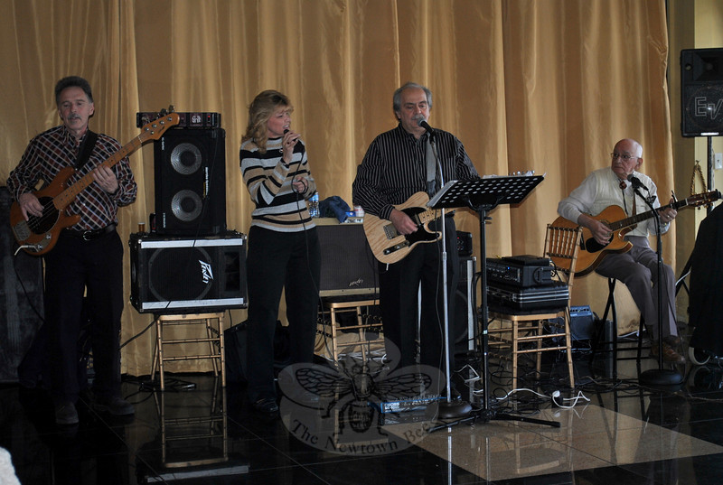 The Country Gentlemen, joined this year by vocalist Doreen Alexander, provided music for dancing and mingling during the Newtown Senior Center Holiday Party.  (Crevier photo)