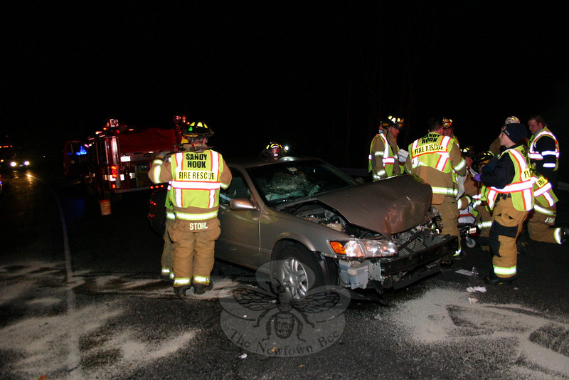 A two-car accident occurred on westbound Berkshire Road (Route 34), at its intersection with Bradley Lane, about 5:13 pm December 13. Police said motorist Kelly Wolf, 49, of 44 Bradley Lane, who was driving a 2007 Lexus sedan westward on Berkshire Road, stopped in preparing to turn left onto Bradley Lane, after which westbound motorist Anita Harris, 66, of 53 The Boulevard, who was driving a 2000 Toyota sedan (above), came around a curve and struck the rear end of the Lexus. Newtown Volunteer Ambulance Corps members transported both drivers to Danbury Hospital. Sandy Hook firefighters responded to the accident. Police issued Harris an infraction for failure to drive a reasonable distance apart.  (Hicks photo)