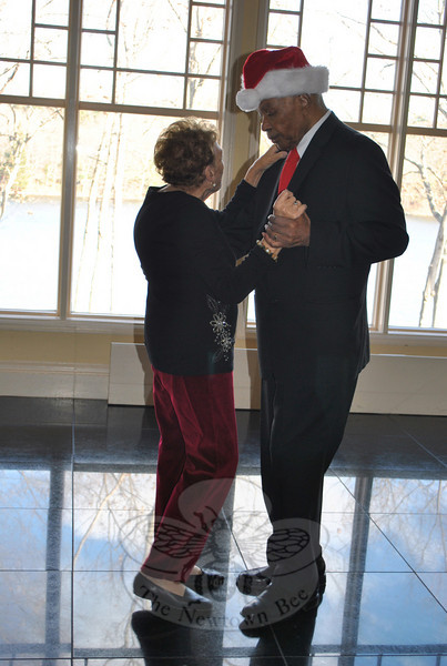Clarence and Lilo Knight, during the Newtown Senior Center Holiday Party.  (Crevier photo)